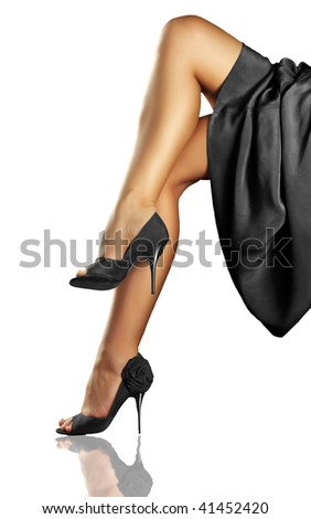 Long woman's legs in the shoes on white background - stock photo