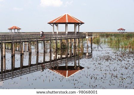 Long wood bridge in big lake,Middle of Thailand. - stock photo