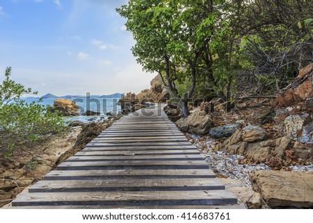 Long wooden bridge go to beautiful tropical beach,Kham Island,Sattahip,Chonburi, Thailand - stock photo