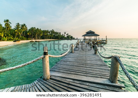 Long wooden bridge pavilion in beautiful tropical island beach sunset - Koh Kood, Trat Thailand - stock photo