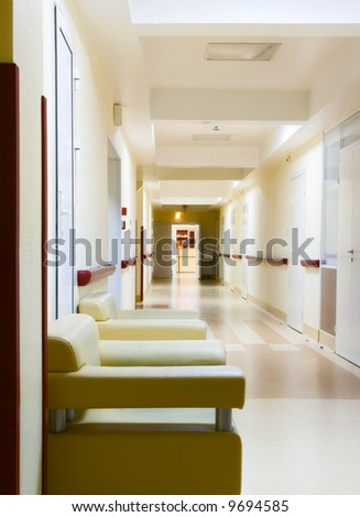 long yellow corridor in hospital - stock photo