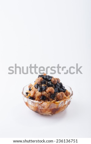 Longan flavored shave ice with Chinese black jelly and dried longan. - stock photo