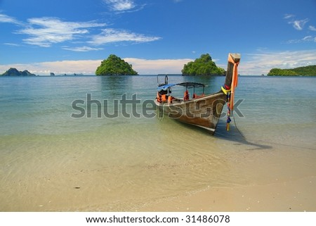 longboat at the beach - stock photo