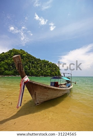 longboat at the beach in thailand - stock photo