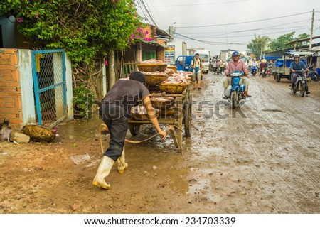 LONGHAI,VIETNAM - November 30, 2014:A traditional fish market on the beach on Nov 30, 2014 in Long Hai town, Baria - Vung Tau province, Southern of Vietnam. This market only happens in early morning.  - stock photo