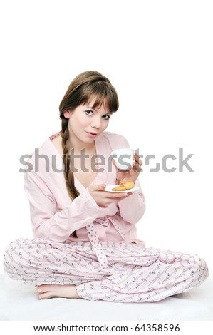 longhaired young woman drinking morning coffee - stock photo