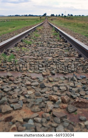 Longitudinal view of train tracks, hdr - stock photo