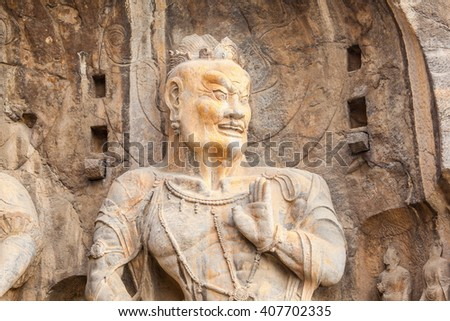 "Longmen Grottoes- Fengxiang temple stone Buddha. It is a world cultural heritage. One of China's four most famous ""Buddhist Caves Art Treasure Houses"", is located Luoyang, Henan, China.    - stock photo"
