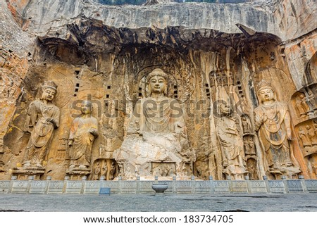 Longmen Grottoes with Buddha's figures are Starting with the Northern Wei Dynasty in 493 AD. It is one of the four notable grottoes in China.  - stock photo