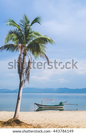 longtail boat and beautiful beach with coconut tree - stock photo