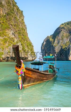 Longtail boat in Maya Bay, Koh Phi Phi Leh, Krabi, Thailand - stock photo