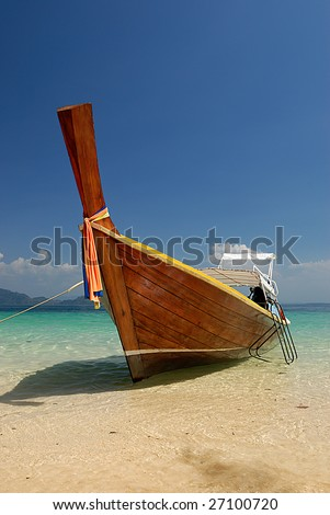 Longtail boat on a beach