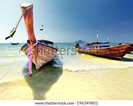 Longtail boat on ropical beach in Krabi, Andaman Sea, Thailand  - stock photo