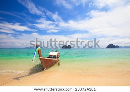 Longtail boat on tropical beach in Krabi, Andaman Sea, Thailand  - stock photo