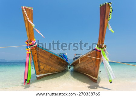 Longtail boats at the tropical beach of Poda island in Andaman sea, Thailand - stock photo