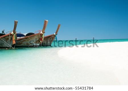 longtail boats on a tropical island near phuket, thailand - stock photo