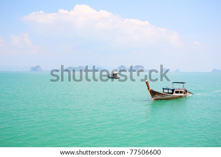 longtail boats runing on phang-nga bay - stock photo