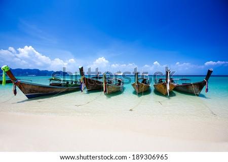 Longtale boat at the beach, Krabi Thailand - stock photo
