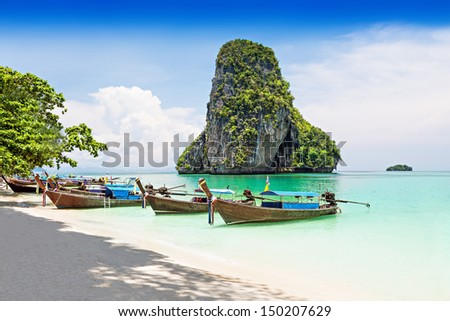 Longtale boats at the beautiful beach, Thailand - focus on the boats - stock photo