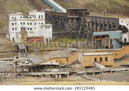 LONGYEARBYEN, NORWAY - SEPTEMBER 03, 2011: Exterior of the ruined coal mine in the abandoned Russian arctic settlement Pyramiden, Norway. - stock photo