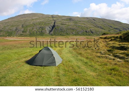 Lonsoraefi area - mountains in Iceland. Camping on green grass. - stock photo