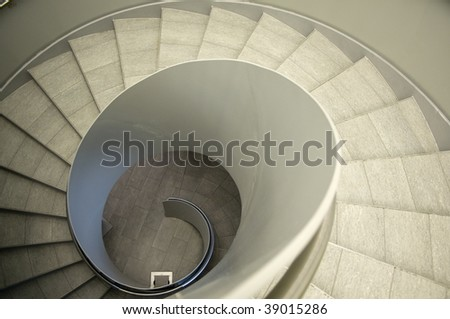 Look down a modern spiral Staircase - stock photo