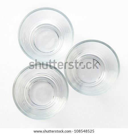 Look down on three empty glasses on a white background - stock photo