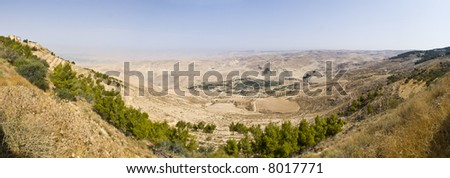 """Look from """"Mount Nebo"""" hill, place of Moses grave, to the valley. Panoramic shot. - stock photo"""