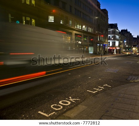 Look Left sign with traffic motion-blur - stock photo
