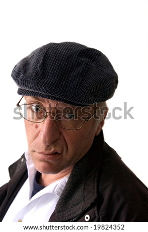 look of disgust on man in hat looking at viewer - stock photo