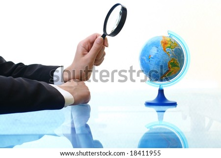 look on globe where to travel - stock photo
