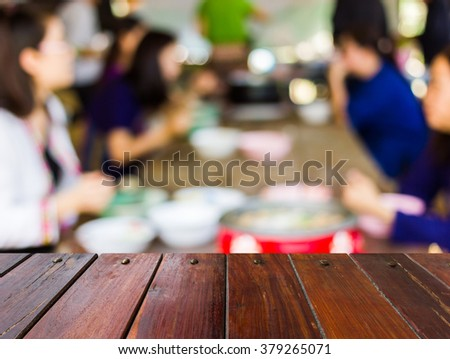 Look out from the table,blur image of eating among friends as background.