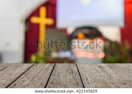 Look out from the table, blur image of inside the church as background. - stock photo
