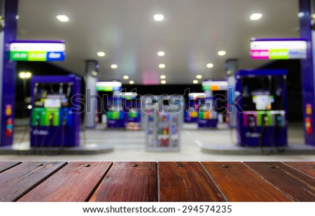 Look out from the table, to see gas station ,use for product presentation related Images. - stock photo