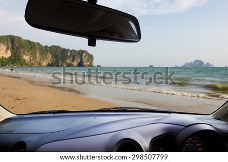 Look out the car window , Blur people play on the beach,use for background. - stock photo