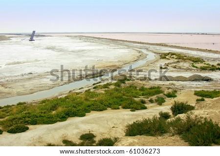 Look over the salt fields Salin de Giraud south of the Camargue - stock photo