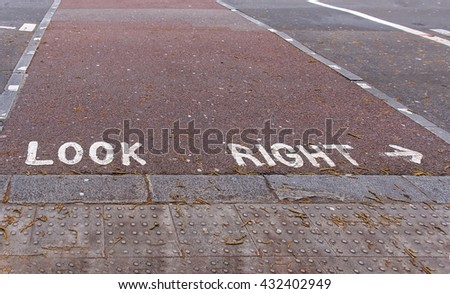 Look right sign on street pavement in London - stock photo