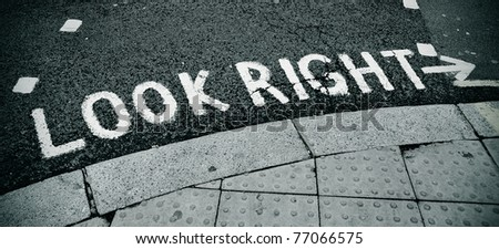 look right sign painted on the road