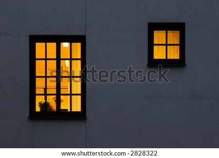 Look through a windows from outside to inside. Lightened one large and half size windows