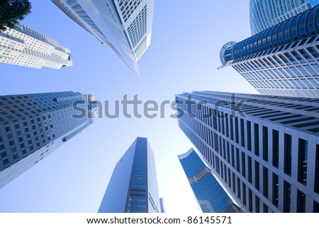Look to the sky surrounded by skyscrapers - stock photo