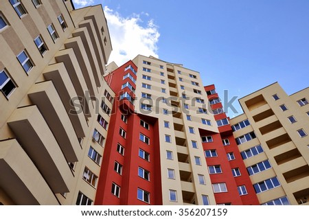 Look up at the facade of modern multistory residential building. - stock photo