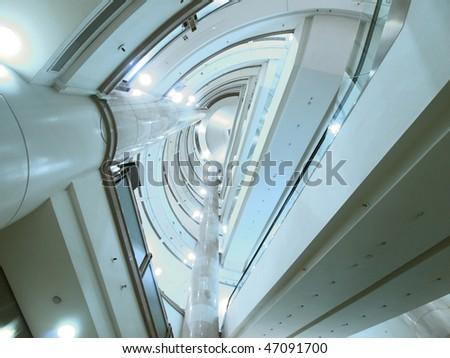 Look upward in modern building - stock photo