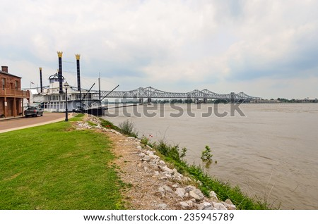 Looking across a Riverboat Casino at the bridge crossing the Mississippi River from Natchez Mississippi to Louisiana. - stock photo