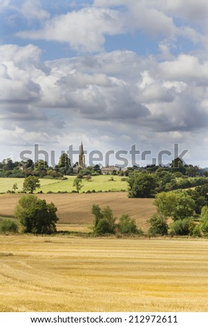 Looking across fields towards Great Wolford in the Cotswolds, Gloucestershire,UK on a sunny summers day - stock photo