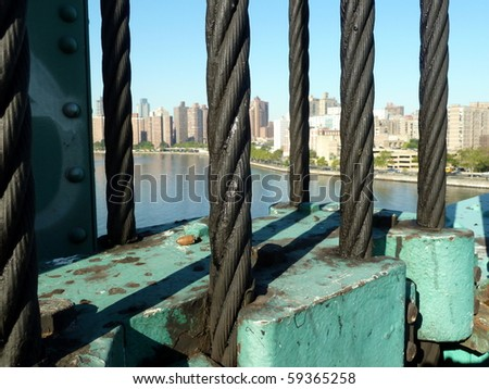 looking across the cables of the Ward Island Pedestrian bridge in Manhattan NYC