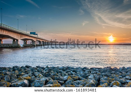 Looking across the Severn Bridge during sunset. - stock photo