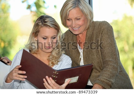 Looking at a family photo album - stock photo