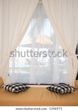 Looking at a gazebo and the beach from a hotel room