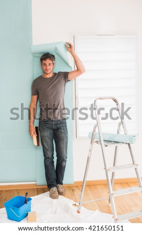 looking at camera, humorous handyman posing wallpaper, poses with his tools and a piece of wallpaper falling on his head
