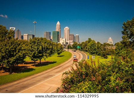 looking at charlotte the queen city financial district from a distance - stock photo
